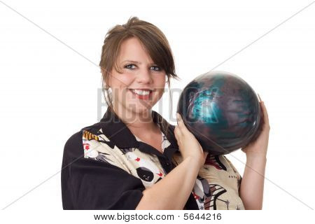 Young happy woman holding a bowling ball; isolated on white