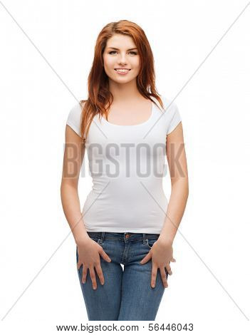 t-shirt design concept - smiling teenager in blank white t-shirt and jeans