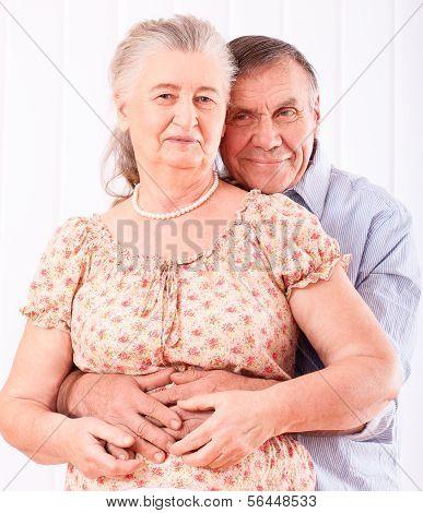 Closeup portrait of smiling elderly couple