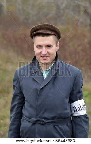 KIEV, UKRAINE -NOV 2:An unidentified member of Red Star history club wears historical Ukrainian collaborationist Police uniform costume historical reenactment of WWII, November 2, 2013.Kiev, Ukraine