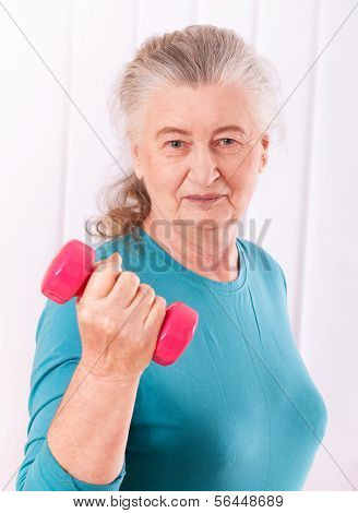 happy senior woman with dumbbells