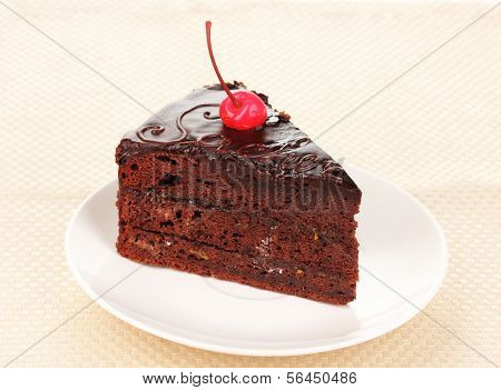 Chocolate sacher cake close-up on napkin