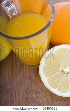 Glasse Of Orange Juice And Fruits