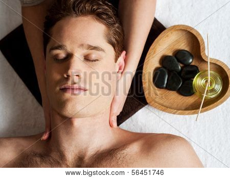 Young Man Getting Face Massage