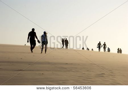 People on the dune top in Jericoacoara Beach