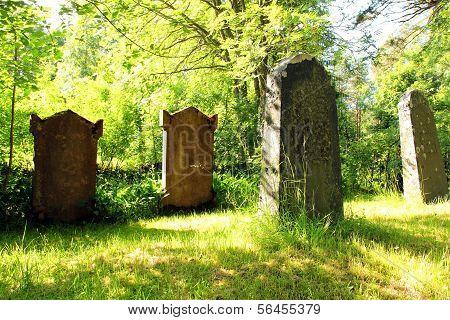Old Tombstones At Church Yard At Midsummer