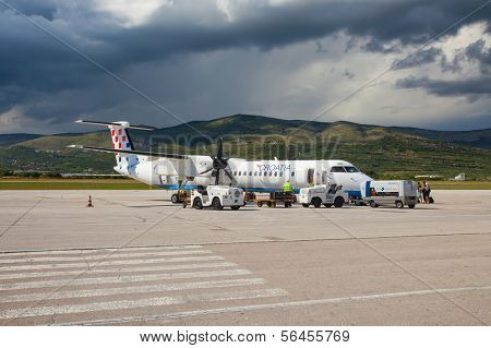 SPLIT, CROATIA - JUN 6: Croatia Airlines Dash 8 Q400 parked on a runway of Split Airport during boarding on June 6, 2013 in Split, Croatia. Airport has very good connections to other European cities.
