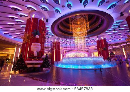MACAU, CHINA - NOVEMBER 3, 2012: Brilliant musical fountain at the entrance to the casino Galaxy Macau. Macau is the gambling capital of Asia and is visited by over 25 million people every year.