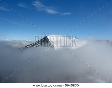 mountain top with snow and clouds new zealand