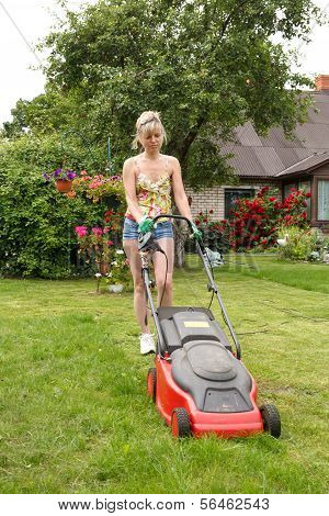 Woman Cuts The Grass