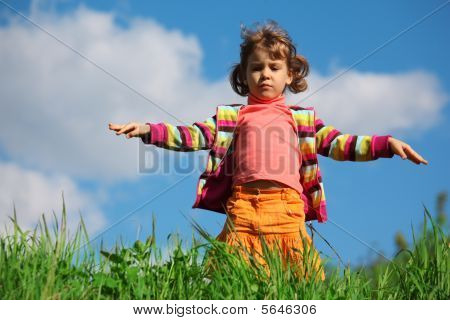 Little Girl On Grass Against Sky