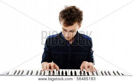 Teenager Playing An Electronic Piano