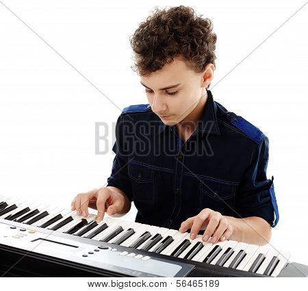 Teenager Playing An Electronic Piano