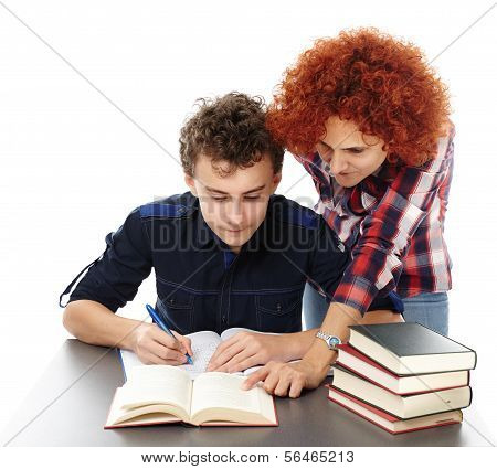 Mother Standing Near Son's Desk Helping Him Doing His Homework