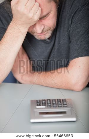 Depressed Man Doing His Finances
