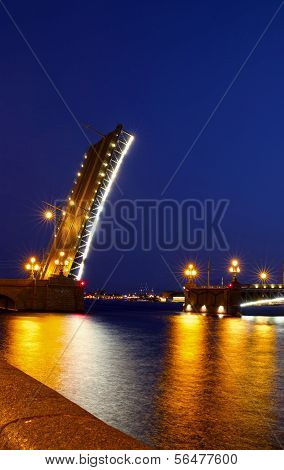 ST. PETERSBURG, RUSSIA - JULY 10: Drawbridge in St. Petersburg at night on July 10, 2013
