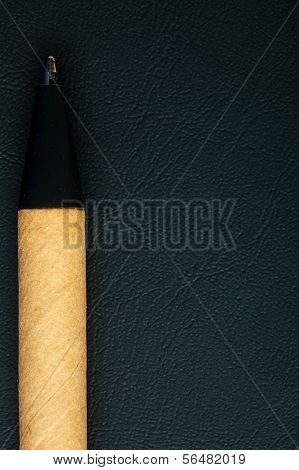 Black Pen Writing Material On Leather Background