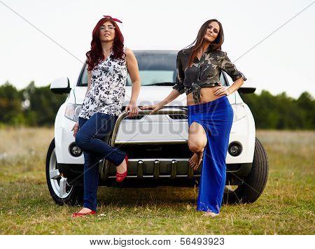 Beautiful Ladies Sitting On A Car
