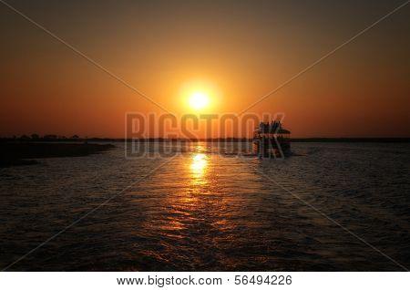 Boattrip in Chobe National Park in dusk, Botswana, Africa