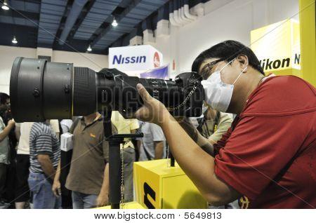 A Visitor Testing Nikon's Camera And Lens