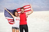 picture of multicultural  - USA athletes people holding american flag cheering - JPG