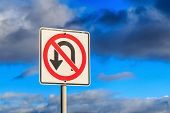"stock photo of traffic rules  - ""No U Turn"" traffic sign against cloudy sky. - JPG"
