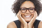 image of geek  - A beautiful intelligent mixed race African American girl or young woman looking happy and wearing geek glasses - JPG