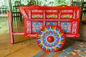 stock photo of scrollwork  - Traditional decorated ox cart in Puerto Limon - JPG