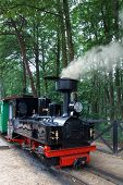 picture of locomotive  - retro small steam locomotive with smoke from the chimney - JPG