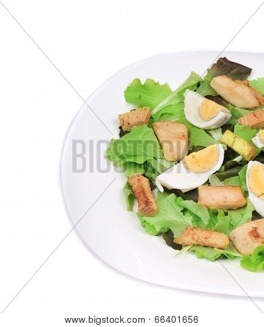 Close up of caesar salad with eggs.