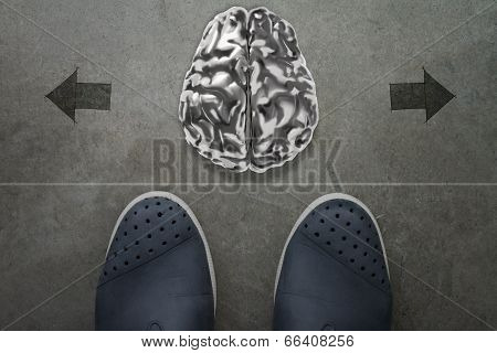 3D Human Metal Brain On Front Of Business Man Feet As Concept