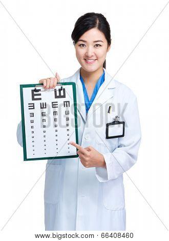 Female doctor hold eye chart