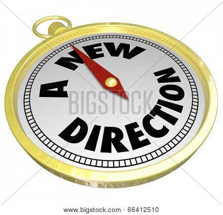 A New Direction words on a gold compass choosing a changed path or way forward
