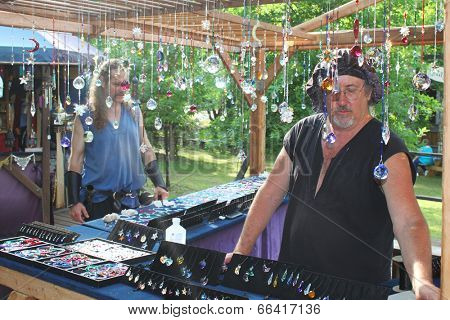 MUSKOGEE, OK - MAY 24: Merchant shows off his crafts for sale at the Oklahoma 19th annual Renaissance Festival on May 24, 2014 at the Castle of Muskogee in Muskogee, OK