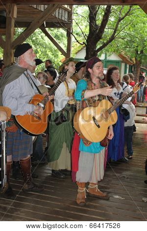 MUSKOGEE, OK - MAY 24: Musicians in historical costumes entertain the crowd at the Oklahoma 19th annual Renaissance Festival on May 24, 2014 at the Castle of Muskogee in Muskogee, OK.