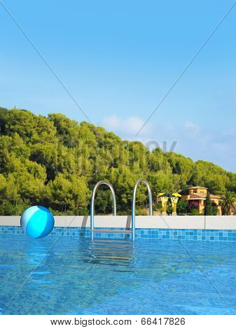 pool with mediterranean landscape