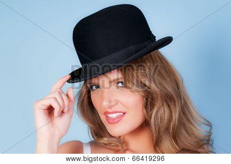 beautiful woman wearing a bowler hat