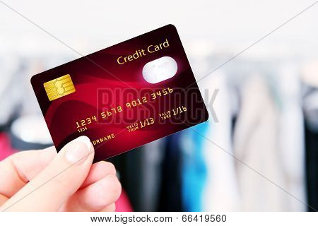 Hand Holding Credit Card In The Shop