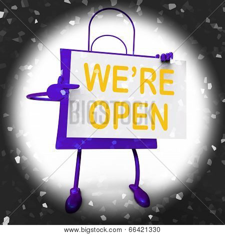 We're Open Sign On Shopping Bag Shows New Store Launch Or Openin