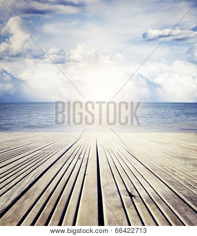 Wooden floor leading to sea and sky