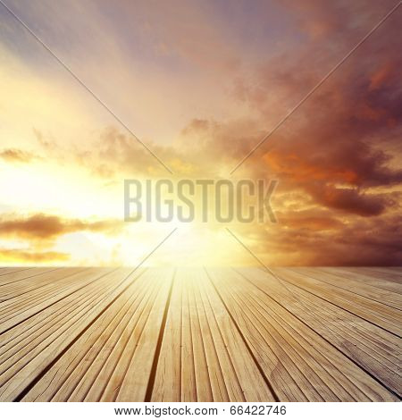 Wooden floor leading to bright sky