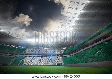 Digitally generated nigerian national flag against football stadium with fans in white