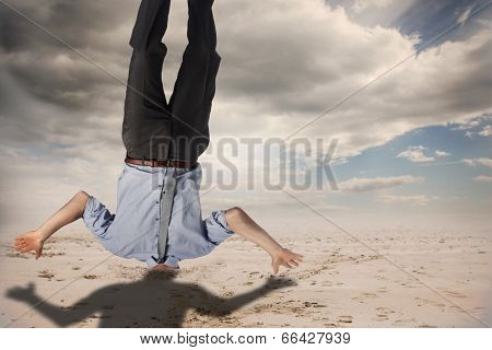 Businessman burying his head against cloudy sky background