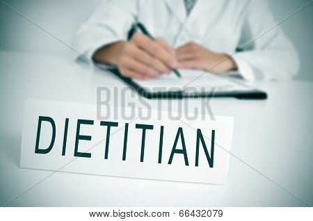 a doctor sitting in a desk with a nameplate in front of him with the word dietitian written in it