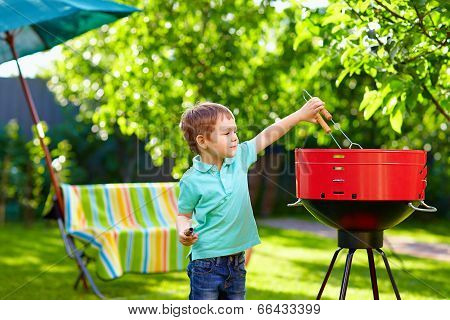 Kid Grilling Food On Backyard Party