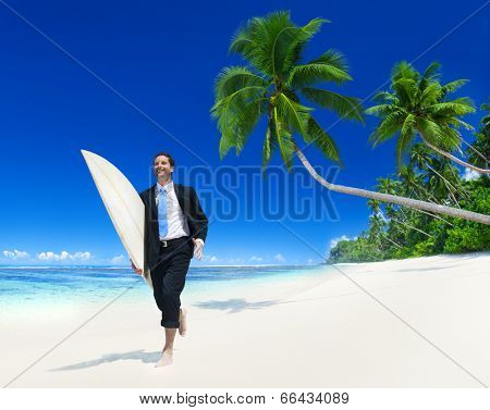 Businessman with surfboard on the beach.