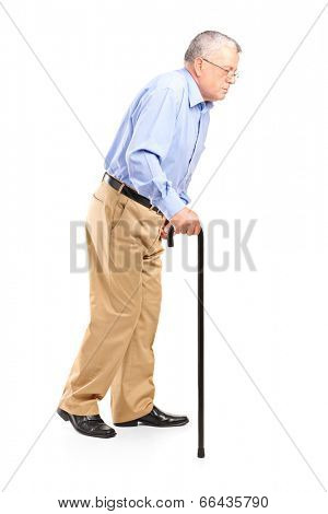 Old man walking with cane isolated on white background
