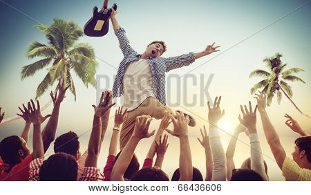 Young Man with a Guitar Performing on a Beach Concert