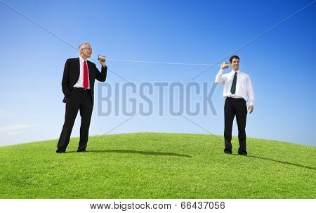 Business Men Outdoors Talking Through Tin Can Phone