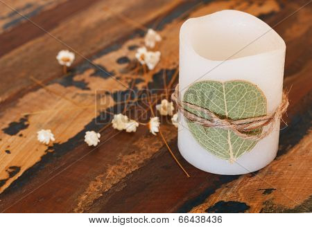Decoration Candle With Dried Leaf Ando Flowers On Wooden Table